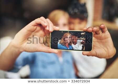 Two vivacious women taking a selfie Stock photo © dash