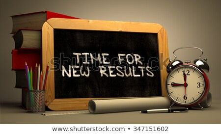 time for new results handwritten by white chalk on a blackboard stock photo © tashatuvango