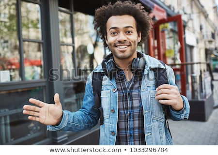 happy afro american man waving hand at camera stock photo © deandrobot