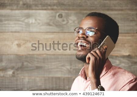 bald businessman wearing glasses posing in studio background stock photo © feedough