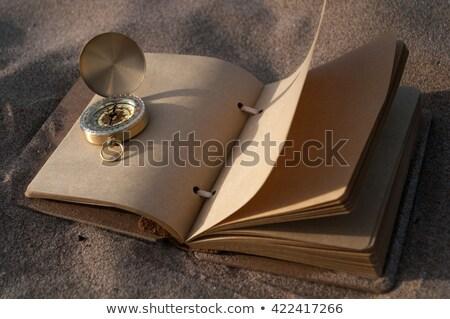 Vintage boek kompas zandstrand vakantie stemming Stockfoto © stevanovicigor