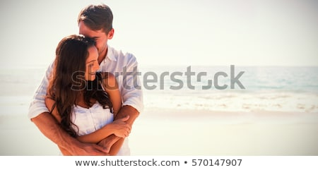 Stock fotó: Fiatal · vonzó · pár · tengerpart · mosoly · férfi