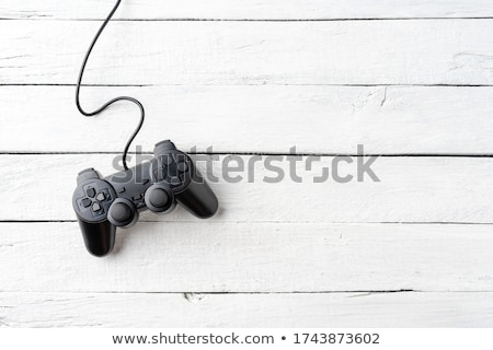 Game pad controller on wooden desk, flat lay top view Stock photo © stevanovicigor