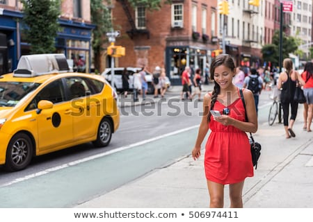 a woman walking while on the phone stock photo © bluering