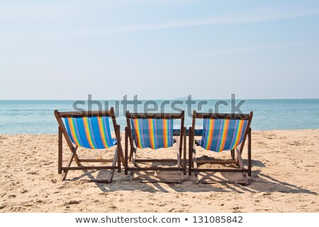 üç kum deniz görmek gün batımı Stok fotoğraf © bank215