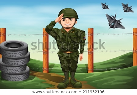 A soldier in front of the barbwire fence Stock photo © bluering