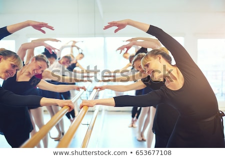 Woman ballerine sretching and exercising in ballet class Stock photo © deandrobot
