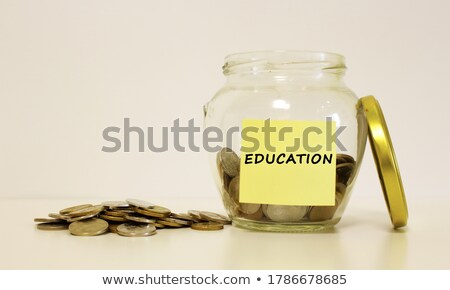 Label on a glass jar with the inscription - education Stock photo © Natali_Brill