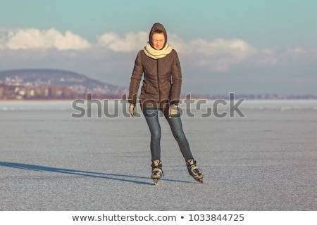 Jeune fille patinage lac Balaton Hongrie femmes Photo stock © digoarpi