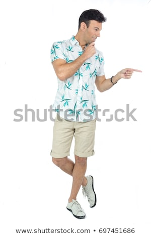 Caucasian traveler pointing to the side. Stock photo © RAStudio