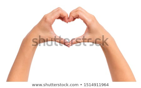 lovely beautiful girl making heart by hands stock photo © deandrobot