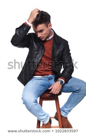 Hideg fiatalember bőrdzseki pihen zsámoly fekete Stock fotó © feedough