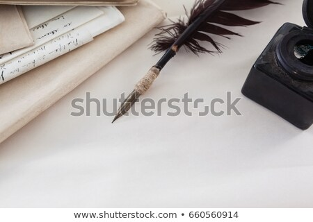 quill feather ink bottle and legal documents arranged on white background stock photo © wavebreak_media