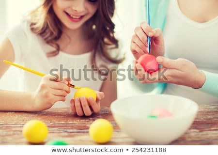 Stockfoto: Close Up Of Woman Hands Coloring Easter Eggs