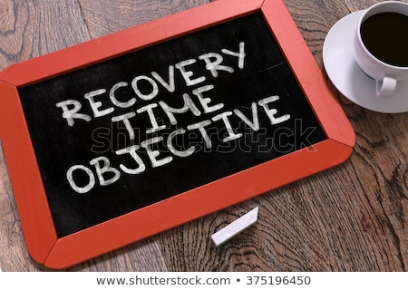 Hand Drawn Recovery Time Objective Concept on Small Chalkboard. Stock photo © tashatuvango