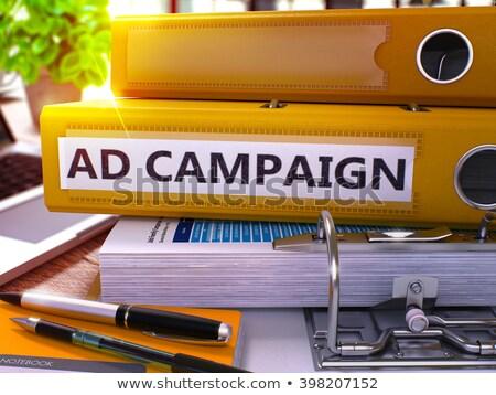 Geel kantoor map opschrift advertentie campagne Stockfoto © tashatuvango