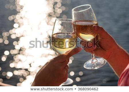 пару · питьевой · шампанского · парусника · женщину · небе - Сток-фото © IS2