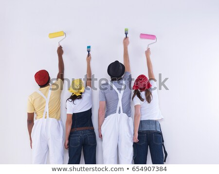 Group of friends about to paint wall. Stock photo © IS2