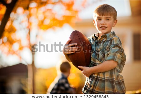 boy holding rugby ball Stock photo © IS2