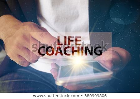 Hand Touching Life Coaching Button. Stock photo © tashatuvango