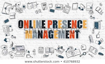 Online Presence Management on White Brick Wall. Stock photo © tashatuvango
