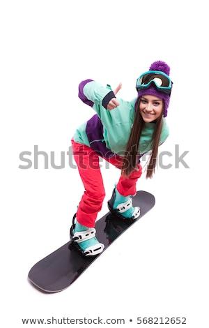young pretty woman in purple ski costume ride snowboard Stock photo © Traimak