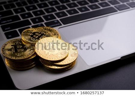 Bitcoins on computer keyboard Stock photo © stevanovicigor