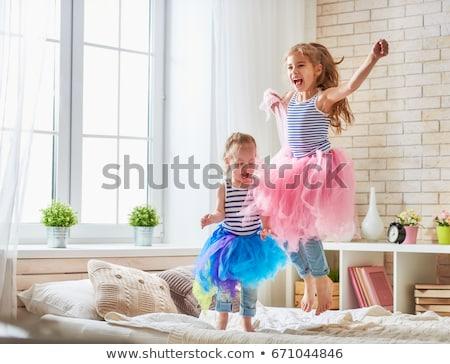 Deux sweet filles lit beauté nuit Photo stock © arturkurjan