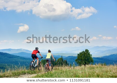 Couple cycling down country road Stock photo © IS2