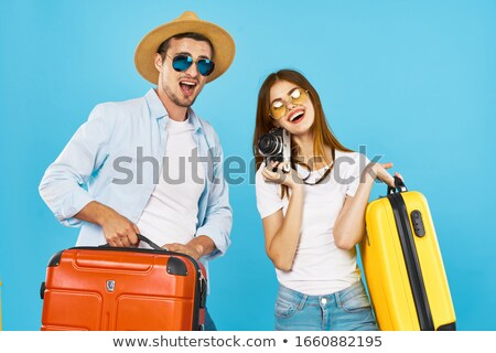 Young travel man with camera stock photo © studioworkstock
