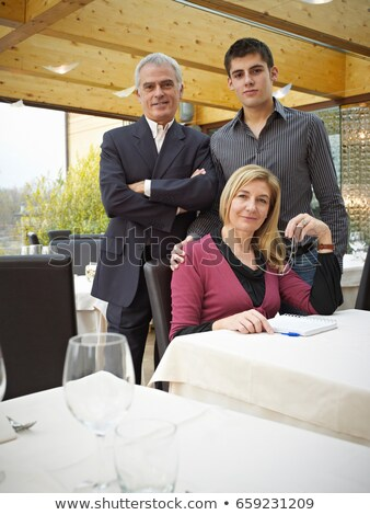 Mother Father and Son in a Restaurant. Handing down the business Stock photo © IS2