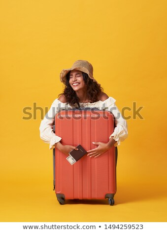 African woman holds suitcase with money Stock photo © studioworkstock