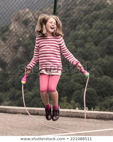Jong meisje springen touw jonge kaukasisch meisje Stockfoto © x7vector