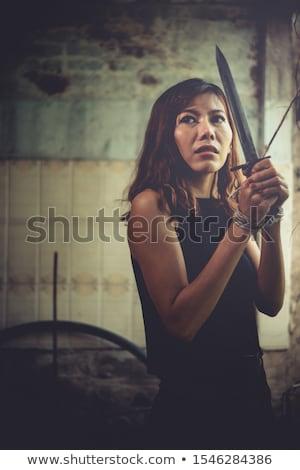 The knifeman threatening tied woman Stock photo © Elnur