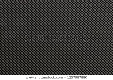 Black metal or plastic texture with holes Stock photo © sidmay