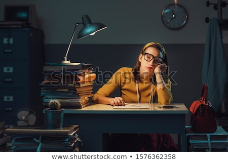 Young woman leaning on stack of files and paperwork Stock photo © IS2