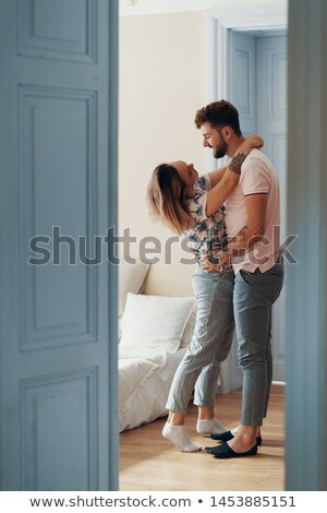 A couple kissing in a doorway. Stock photo © IS2