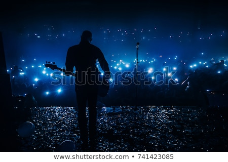 Guitar player in front of spotlight Stock photo © sumners