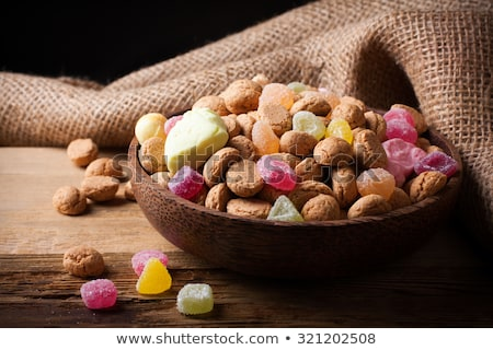Wooden bowl with typical dutch sweets for Sinterklaas  Stock photo © Melnyk
