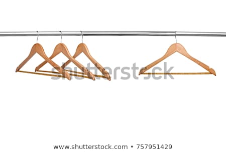 white hangers in the empty wardrobe stock photo © nobilior