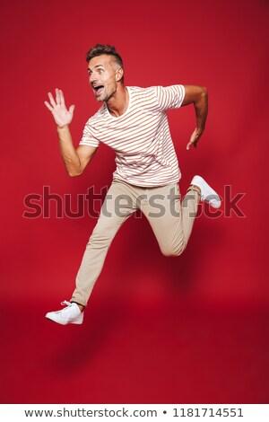 Foto caucasiano homem listrado tshirt Foto stock © deandrobot