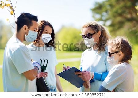 csoport · önkéntesek · vágólap · park · önkéntesség · jótékonyság - stock fotó © dolgachov