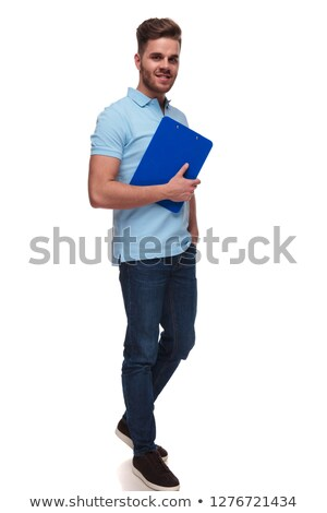 relaxed casual man holding neck walks to side and smiles Stock photo © feedough