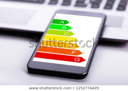 Mobiele telefoon energie-efficiëntie grafiek scherm laptop Stockfoto © AndreyPopov