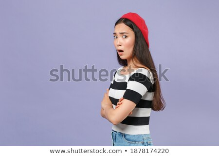 Retrato preocupado mulher jovem boina em pé Foto stock © deandrobot