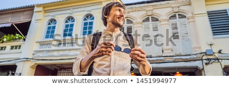 Man tourist on the Street in the Portugese style Romani in Phuket Town. Also called Chinatown or the Stock photo © galitskaya