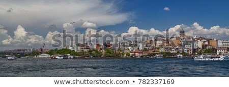 panoramic view of istanbul golden horn and galata bridge with tourist ships floating at bosphorus stock photo © artjazz