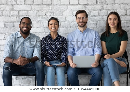 Group of people with devices in hands working on laptops and tab Stock photo © ra2studio