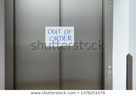 Out Of Order Text On Closed Elevator Door Stock photo © AndreyPopov