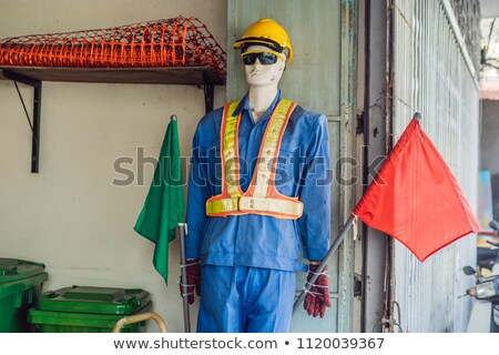 Fake traffic mannequin in the clothes of a road worker Stock photo © galitskaya
